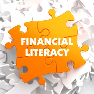 Financial Literacy on Orange Puzzle on White Background.
