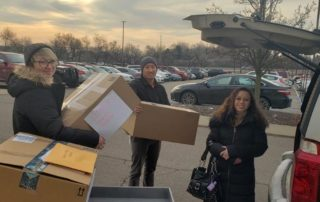Delaney Gloger, Scott Schmaltz & Aubreigh Sabbota – packing the cars to deliver the gifts